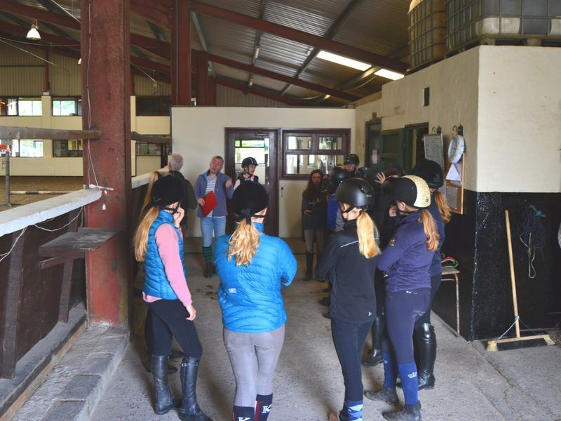 horse riders and profesor at intensive equestrian class
